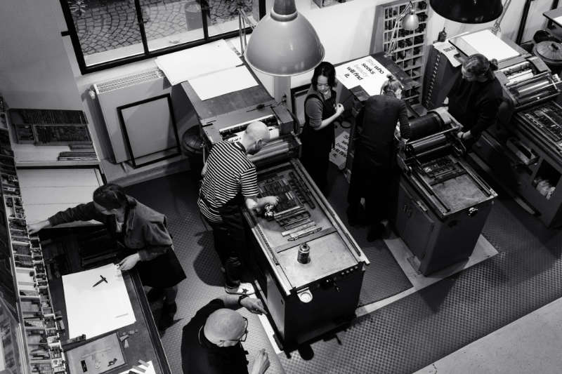 A photo from above onto attendees of a letter press workshop at p98a