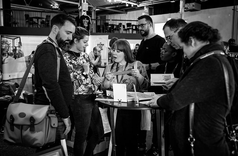 Photo shows attendees during the break in the exhibition