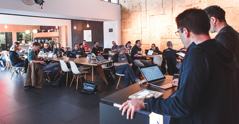 A photo showing the opening session at the Indie Web Camp in Düsseldorf with speakers and attendees.